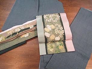結城紬に四季の花々丸紋刺繍名古屋帯