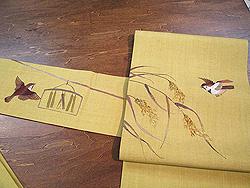 辛子色に稲穂雀の刺繍名古屋帯