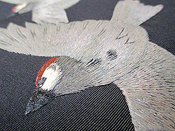 黒地雪に雀刺繍名古屋帯