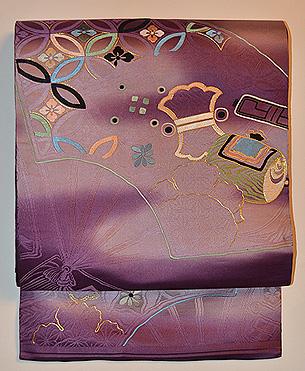 紫地扇面の図丸帯