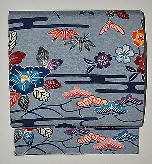 エ霞に四季の花紋紅型染名古屋帯