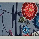 エ霞に四季の花紋紅型染名古屋帯 前中心