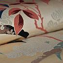 雪輪に菊と南天の織名古屋帯 質感・風合