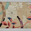 雪輪に菊と南天の織名古屋帯 前中心
