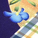 団十郎格子に春の小花の図名古屋帯 質感・風合