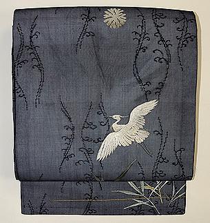蛇籠に飛翔鷺の図紗名古屋帯