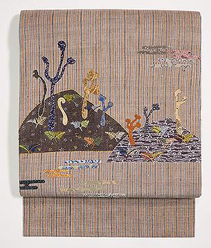 霞に遠山、早蕨のコラージュ名古屋帯