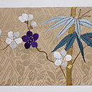 綸子地に梅と竹刺繍名古屋帯 前柄