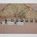 横笛の刺繍名古屋帯 前柄