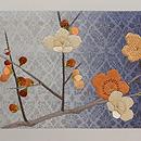 椿に梅刺繍名古屋帯 前柄