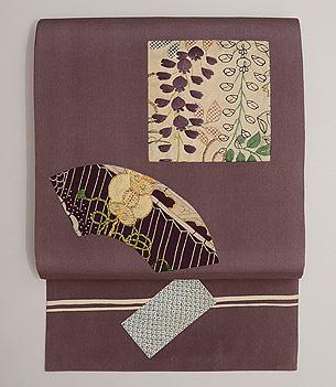 紫地春文様切り嵌め名古屋帯