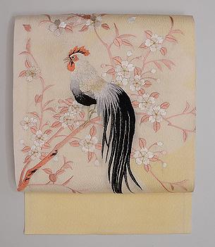 桜に尾長鶏の刺繍名古屋帯