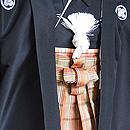 黒紋付に茶格子袴